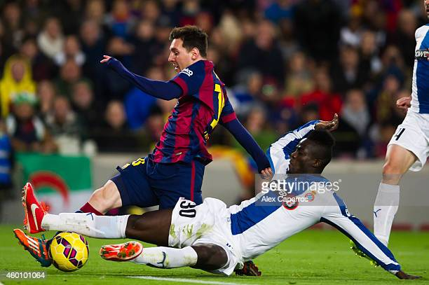 Lionel Messi of FC Barcelona and Eric Bailly of RCD Espanyol fight for the ball during the La Liga match between FC Barcelona and RCD Espanyol at...