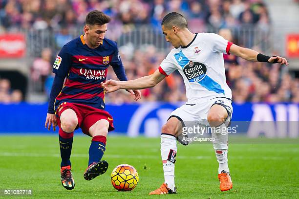 Lionel Messi of FC Barcelona and Faycal Fajr of RC Deportivo La Coruna compete for the ball during the La Liga match between FC Barcelona and RC...