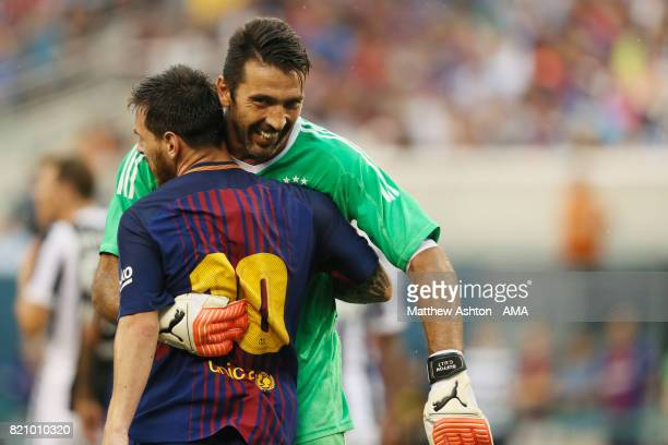 Lionel Messi of FC Barcelona and Gianluigi Buffon of Juventus embrace during the International Champions Cup 2017 match between Juventus and FC...