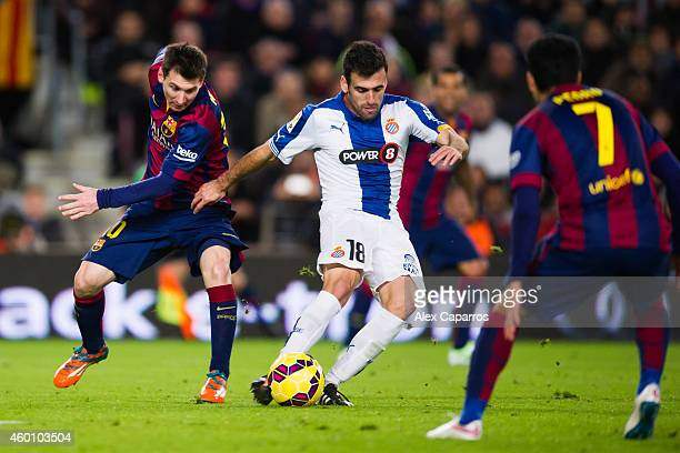 Lionel Messi of FC Barcelona and Juan Fuentes of RCD Espanyol compete for the ball during the La Liga match between FC Barcelona and RCD Espanyol at...