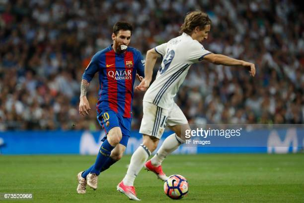Lionel Messi of FC Barcelona and Luka Modric of Real Madrid battle for the ball during the La Liga match between Real Madrid CF and FC Barcelona at...