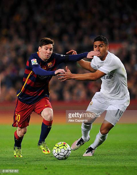 Lionel Messi of FC Barcelona battles for the ball with Casemiro of Real Madrid CF during the La Liga match between FC Barcelona and Real Madrid CF at...