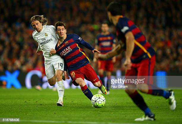 Lionel Messi of FC Barcelona battles for the ball with Luka Modric of Real Madrid CF during the La Liga match between FC Barcelona and Real Madrid CF...