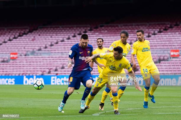 Lionel Messi of FC Barcelona battles for the ball with Ximo Navarro of UD Las Palmas during the La Liga match between Barcelona and Las Palmas at...