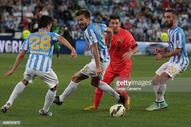 Lionel Messi of FC Barcelona beats Ignacio Camacho of Malaga CF during the La Liga match between Malaga CF and FC Barcelona at La Rosaleda studium on...