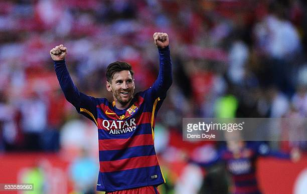 Lionel Messi of FC Barcelona celebrates after his team beat Sevilla 20 in the Copa del Rey Final between Barcelona and Sevilla at Vicente Calderon...