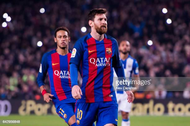 Lionel Messi of FC Barcelona celebrates after kicking a penalty shot and scoring his team's second goal during the La Liga match between FC Barcelona...