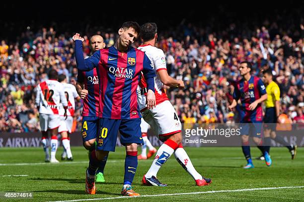 Lionel Messi of FC Barcelona celebrates after scoring from the penalty spot his team's third goal during the La Liga match between FC Barcelona and...