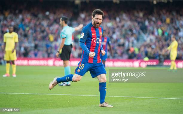 Lionel Messi of FC Barcelona celebrates after scoring his team's 2nd goal during of the La Liga match between FC Barcelona and Villarreal CF at Camp...