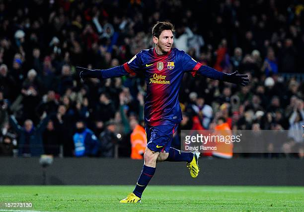 Lionel Messi of FC Barcelona celebrates after scoring his team's fifth goal during the La Liga match between FC Barcelona and Athletic Club at Camp...