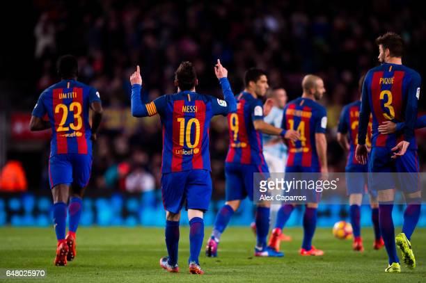 Lionel Messi of FC Barcelona celebrates after scoring his team's fifth goal during the La Liga match between FC Barcelona and RC Celta de Vigo at...