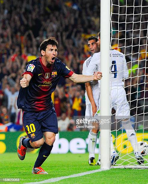 Lionel Messi of FC Barcelona celebrates after scoring his team's first goal during the La Liga match between FC Barcelona and Real Madrid CF at Camp...
