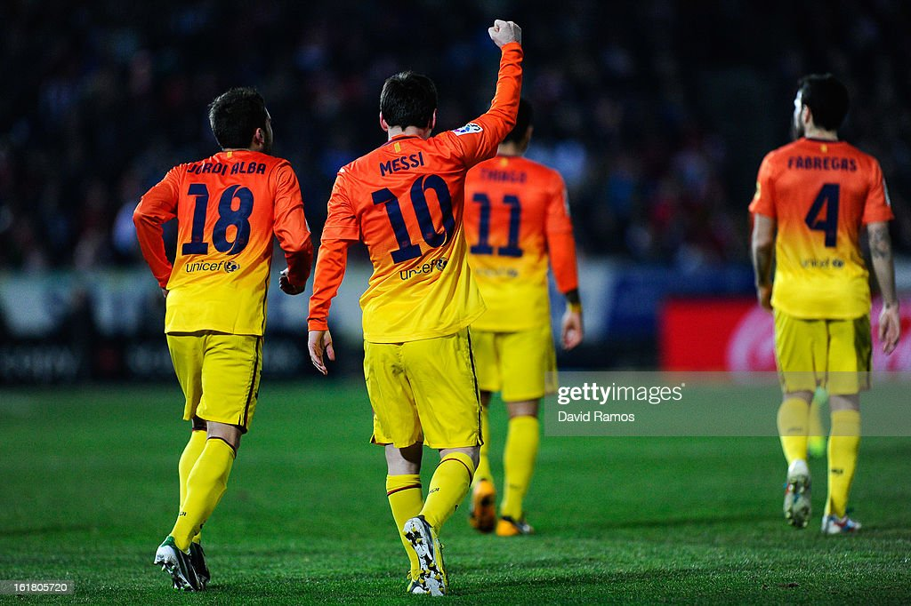 <a gi-track='captionPersonalityLinkClicked' href=/galleries/search?phrase=Lionel+Messi&family=editorial&specificpeople=453305 ng-click='$event.stopPropagation()'>Lionel Messi</a> of FC Barcelona celebrates after scoring his team's second goal during the La Liga match between Granada CF and FC Barcelona at Estadio Nuevo Los Carmenes on February 16, 2013 in Granada, Spain.