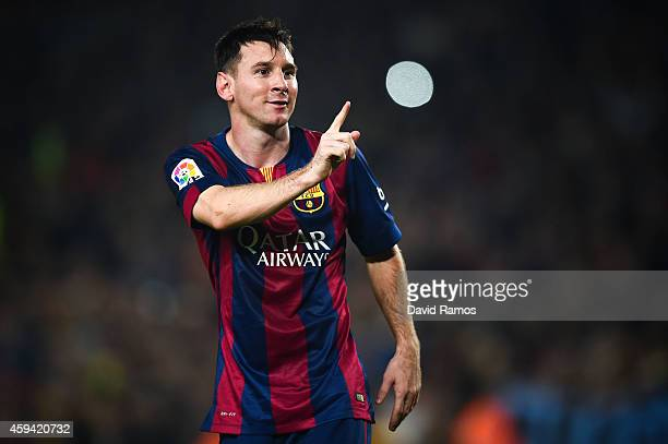Lionel Messi of FC Barcelona celebrates after scoring his team's fourth goal during the La Liga match between FC Barcelona and Sevilla FC at Camp Nou...