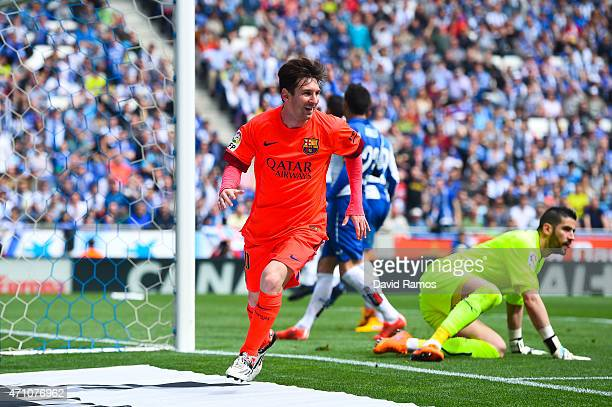 Lionel Messi of FC Barcelona celebrates after scoring his team's second goal during the La Liga match between RCD Espanyol and FC Barcelona at...