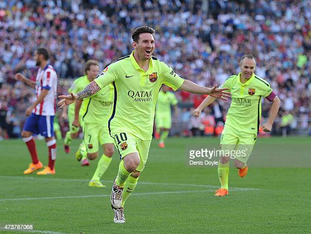 Lionel Messi of FC Barcelona celebrates after scoring his team's opening goal during the La Liga match between Club Atletico de Madrid and FC...
