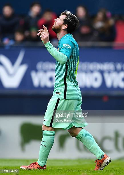 Lionel Messi of FC Barcelona celebrates after scoring his team's second goal during the La Liga match between CA Osasuna and FC Barcelona at Sadar...