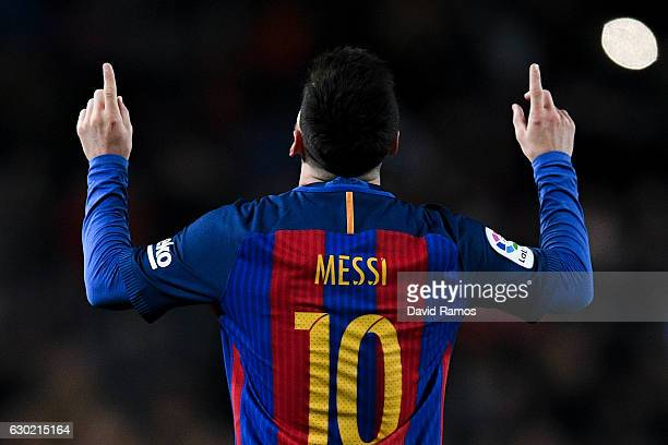 Lionel Messi of FC Barcelona celebrates after scoring his team's fourth goal during the La Liga match between FC Barcelona and RCD Espanyol at the...