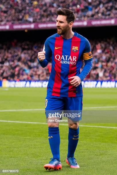 Lionel Messi of FC Barcelona celebrates after scoring his team's second goal during the La Liga match between FC Barcelona and Athletic Club at Camp...
