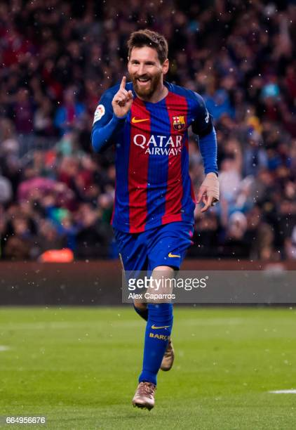 Lionel Messi of FC Barcelona celebrates after scoring his team's second goal during the La Liga match between FC Barcelona and Sevilla FC at Camp Nou...