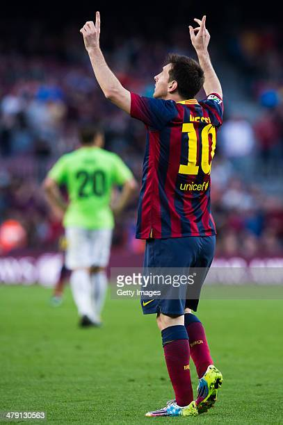 Lionel Messi of FC Barcelona celebrates after scoring his team's sixth goal during the La Liga match between FC Barcelona and CA Osasuna at Camp Nou...