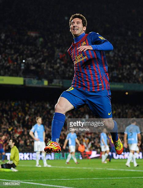 Lionel Messi of FC Barcelona celebrates after scoring his team's third goal during the round of last 16 Copa del Rey 1st leg match between FC...