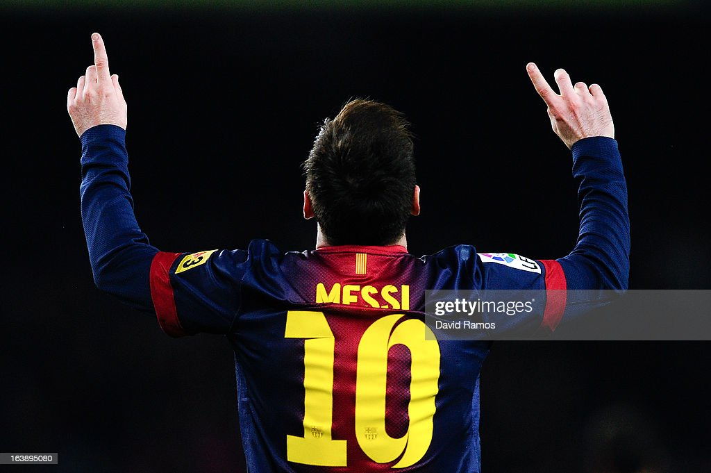 <a gi-track='captionPersonalityLinkClicked' href=/galleries/search?phrase=Lionel+Messi&family=editorial&specificpeople=453305 ng-click='$event.stopPropagation()'>Lionel Messi</a> of FC Barcelona celebrates after scoring his team's third goal during the La Liga match between FC Barcelona and Rayo Vallecano at Camp Nou on March 17, 2013 in Barcelona, Spain.
