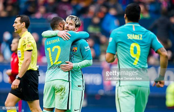 Lionel Messi of FC Barcelona celebrates after scoring his team's third goal during the La Liga match between CA Osasuna and FC Barcelona at Estadio...