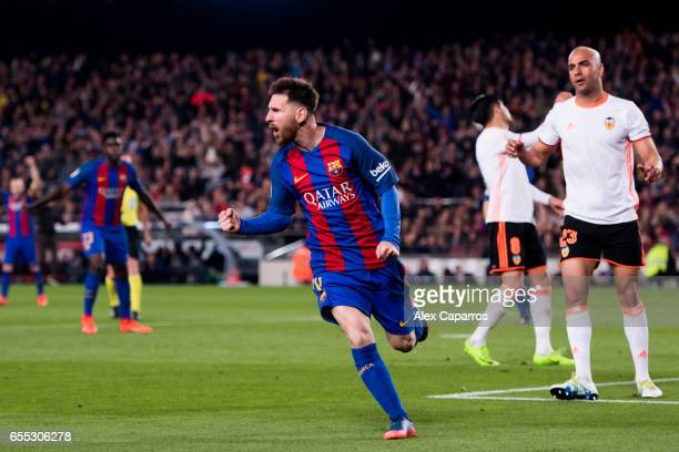 Lionel Messi of FC Barcelona celebrates after scoring his team's third goal during the La Liga match between FC Barcelona and Valencia CF at Camp Nou...