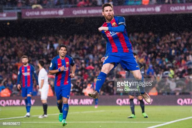 Lionel Messi of FC Barcelona celebrates after scoring his team's third goal during the La Liga match between FC Barcelona and Sevilla FC at Camp Nou...