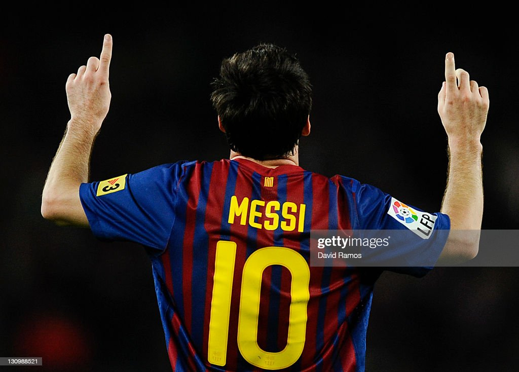 Lionel Messi of FC Barcelona celebrates after scoring his third team's goal during the La Lliga match between FC Barcelona and RCD mallorca at Camp Nou on October 29, 2011 in Barcelona, Spain.