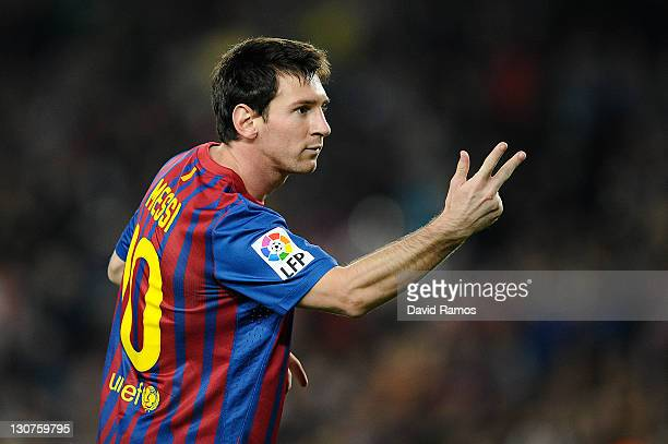 Lionel Messi of FC Barcelona celebrates after scoring the opening goal during the La Lliga match between FC Barcelona and RCD mallorca at Camp Nou on...