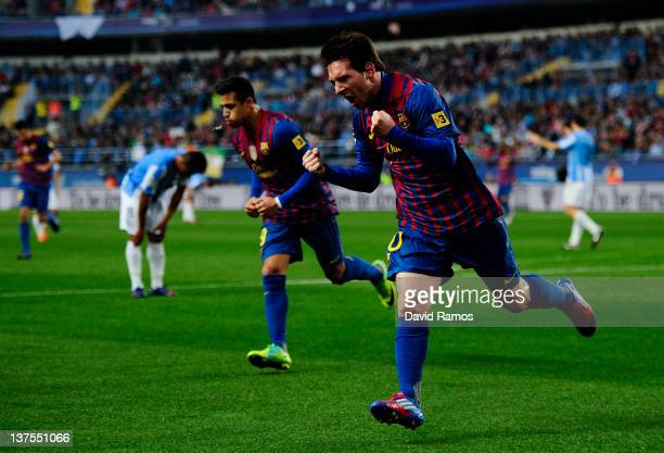 Lionel Messi of FC Barcelona celebrates after scoring the opening goal during the La Liga match between Malaga CF and FC Barcelona at Rosaleda...