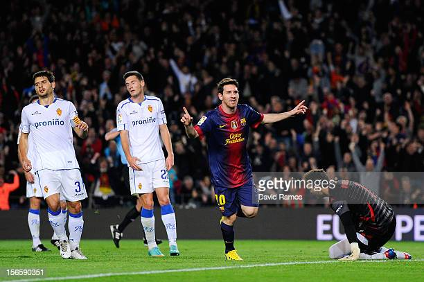 Lionel Messi of FC Barcelona celebrates after scoring the opening goal during the La Liga match between FC Barcelona and Real Zaragoza at Camp Nou on...