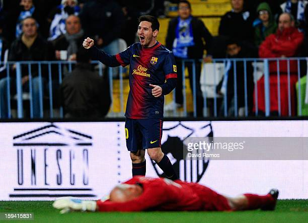 Lionel Messi of FC Barcelona celebrates after scoring the opening goal during the La Liga match between Malaga CF and FC Barcelona at La Rosaleda...