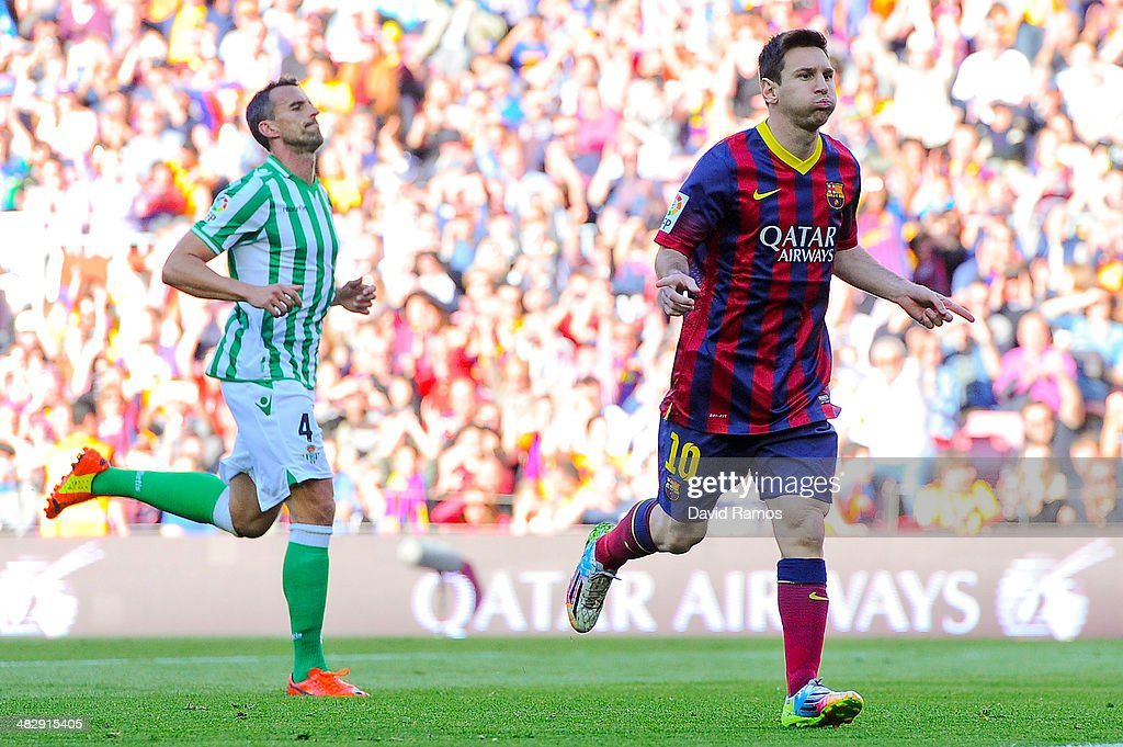 Lionel Messi of FC Barcelona celebrates after scoring the opening goal during the La Liga match between FC Barcelona and Real Betis Balompie at Camp...