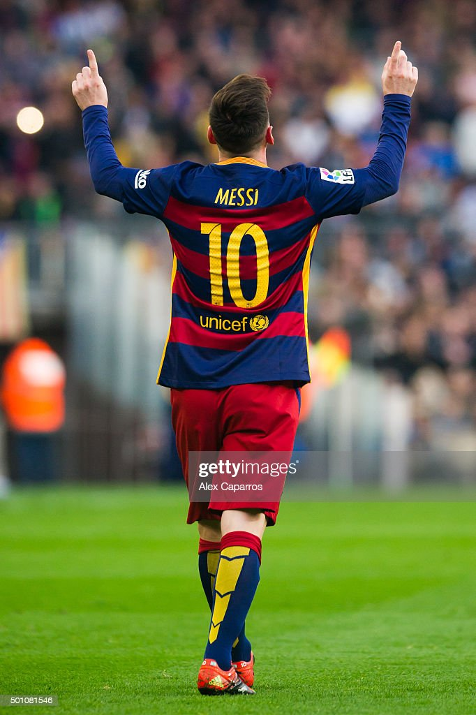 Lionel Messi of FC Barcelona celebrates after scoring the opening goal during the La Liga match between FC Barcelona and RC Deportivo La Coruna at Camp Nou on December 12, 2015 in Barcelona, Spain.
