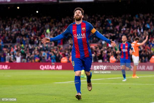 Lionel Messi of FC Barcelona celebrates after scoring the opening goal during the La Liga match between FC Barcelona and CA Osasuna at Camp Nou...