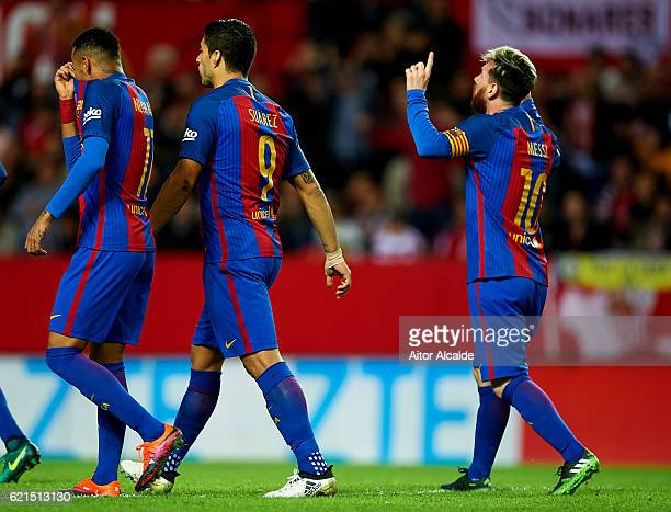 Lionel Messi of FC Barcelona celebrates after scoring their first goal during the match between Sevilla FC vs FC Barcelona as part of La Liga at...