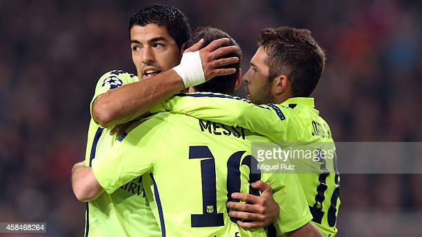 Lionel Messi of FC Barcelona celebrates his goal with Luis Suarez and Jordi Alba during the UEFA Champions League match between AFC Ajax and FC...