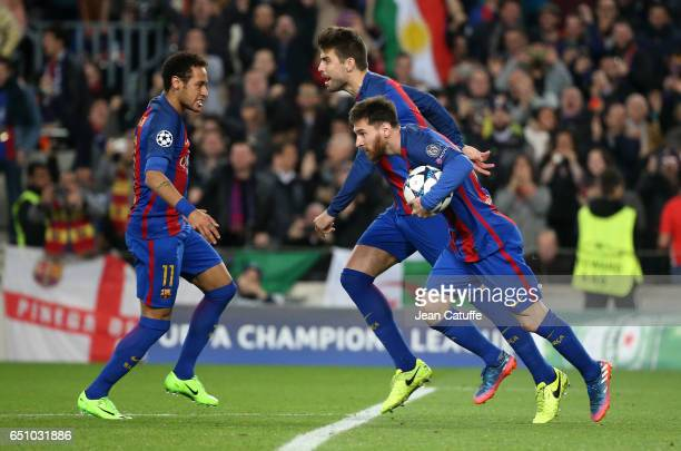 Lionel Messi of FC Barcelona celebrates scoring his penalty with Neymar Jr and Gerard Pique during the UEFA Champions League Round of 16 second leg...