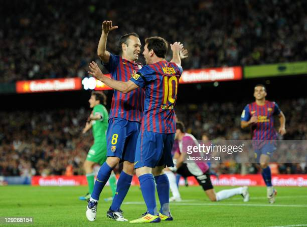 Lionel Messi of FC Barcelona celebrates scoring his sides opening goal with his teammate Andres Iniesta during the la Liga match between FC Barcelona...