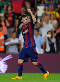 Lionel Messi of FC Barcelona celebrates scoring his team's opening goal during the La Liga match between FC Barcelona and Elche FC at Camp Nou...