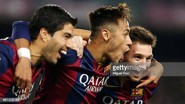 Lionel Messi of FC Barcelona celebrates scoring his team's third goal with teammates Neymar and Luis Suarez during the La Liga match between FC...