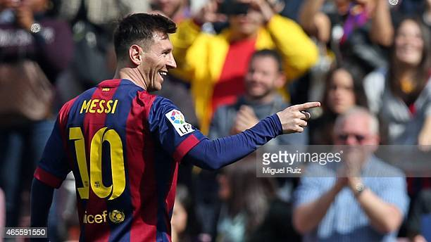 Lionel Messi of FC Barcelona celebrates scoring the fifth goal during the La Liga match between FC Barcelona and Rayo Vallecano at Camp Nou on March...