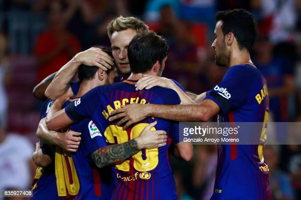 Lionel Messi of FC Barcelona celebrates scoring their opening goal with teammates Sergi Roberto Sergio Busquets Burgos and Ivan Rakitic during the La...