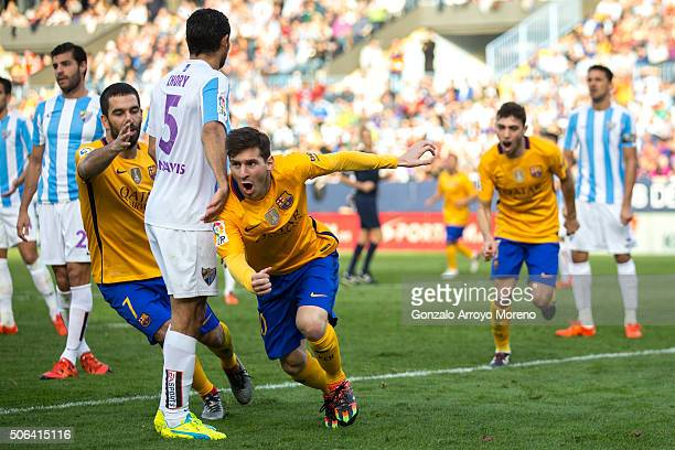 Lionel Messi of FC Barcelona celebrates scoring their second goal during the La Liga match between Malaga CF and FC Barcelona at La Rosaleda Stadium...