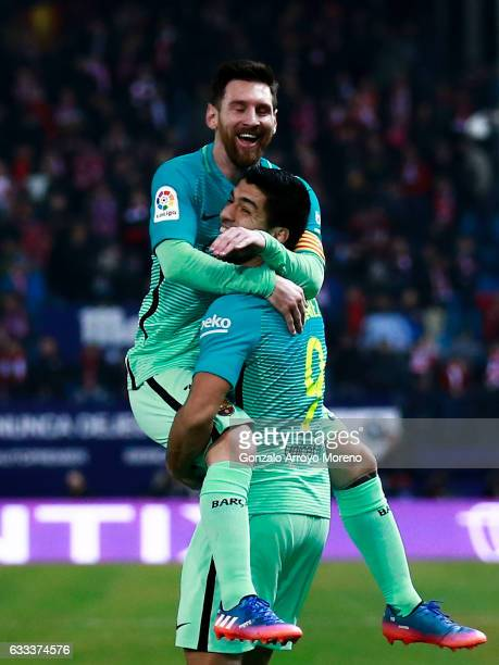 Lionel Messi of FC Barcelona celebrates scoring their second goal with teammate Luis Suarez a during the Copa del Rey semifinal first leg match...