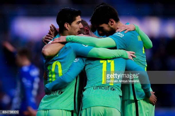 Lionel Messi of FC Barcelona celebrates scoring their third goal with teammates Luis Suarez Neymar JR and Andre Gomes during the La Liga match...