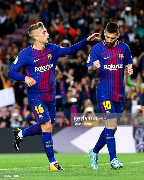 Lionel Messi of FC Barcelona celebrates with his team mate Gerard Deulofeu of FC Barcelona after scoring his team's first goal from the penalty spot...